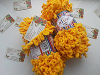 Турецкая фантазийная пряжа Puffy fine Alize желтого цвета 82