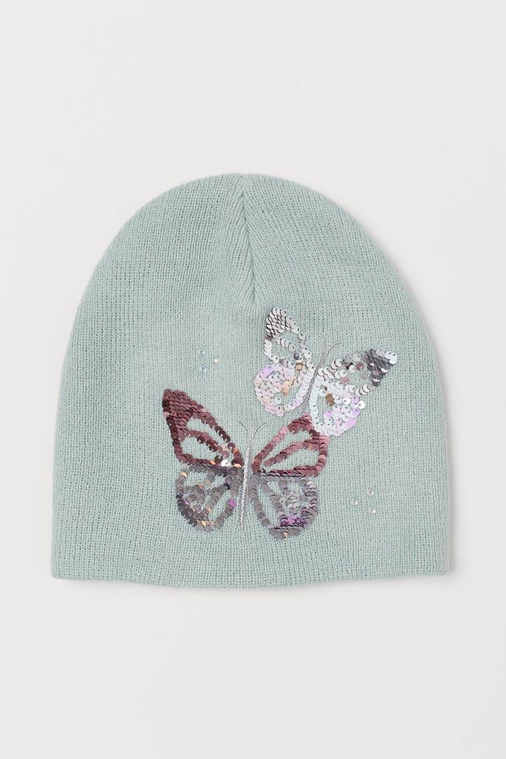 Демисезонная двохслойная шапочка бабочки из реверсивных пайеток для девочки