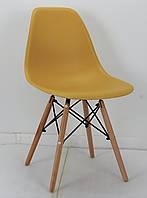 Стул из пластика Nik  - N (Ник Н) желто-горчичный 11 на деревянных ножках