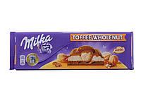 Шоколад Milka с начинкой целый орех и карамель 300г 10488185