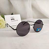 Круглые стильные солнцезащитные очки в металлической оправе на узкое лицо