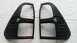 Toyota Hilux Revo 2014+ накладки черные на задние фонари
