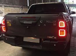 Toyota Hilux Revo 2014+ накладки черные на задние фонари с LED