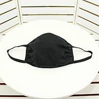 Защитная маска для лица, черного цвета.