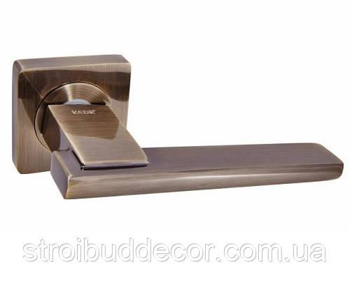 Ручка дверная  KEDR R 08.142-AL-AB цвет бронза