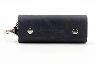 Кожаная ключница фирмы Grande Pelle черного цвета (13927)