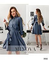 Модное платье с пуговицами на планке спереди