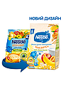 """Молочна каша Nestle """"Рис, кукурудза з яблуком, бананом i абрикосом"""" 230г, фото 2"""