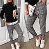 Женские трикотажные прямые брюки с отворотами