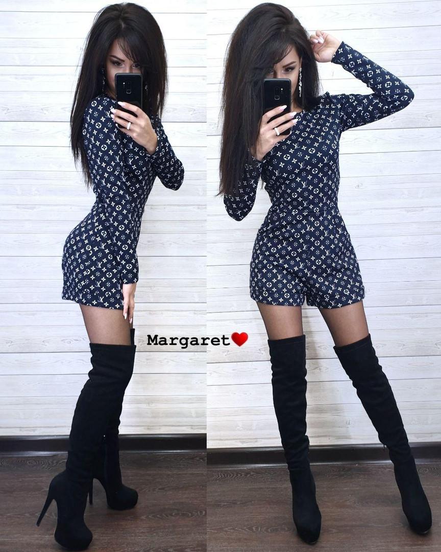 Стильный женский комбинезон с шортами и карманами