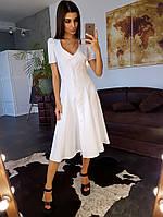 Белое платье миди на пуговицах с глубоким вырезом