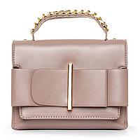 Компактная женская сумочка из искусственной кожи.