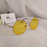 Круглые стильные солнцезащитные очки в металлической оправе с желтыми линзами