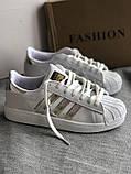 Спортивные белые кроссовки с серебристыми полосками, фото 5