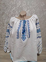 Женская вышиванка с синей вышивкой