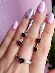Комплект  серебряных украшений с красными камнями