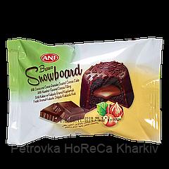 Кекс Brawo Snow Board шоколадний з горіховим кремом покритий какао гранулами 50г 1уп/24шт