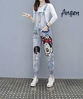 Фантастический женский джинсовый комбинезон с манжетами и паетками