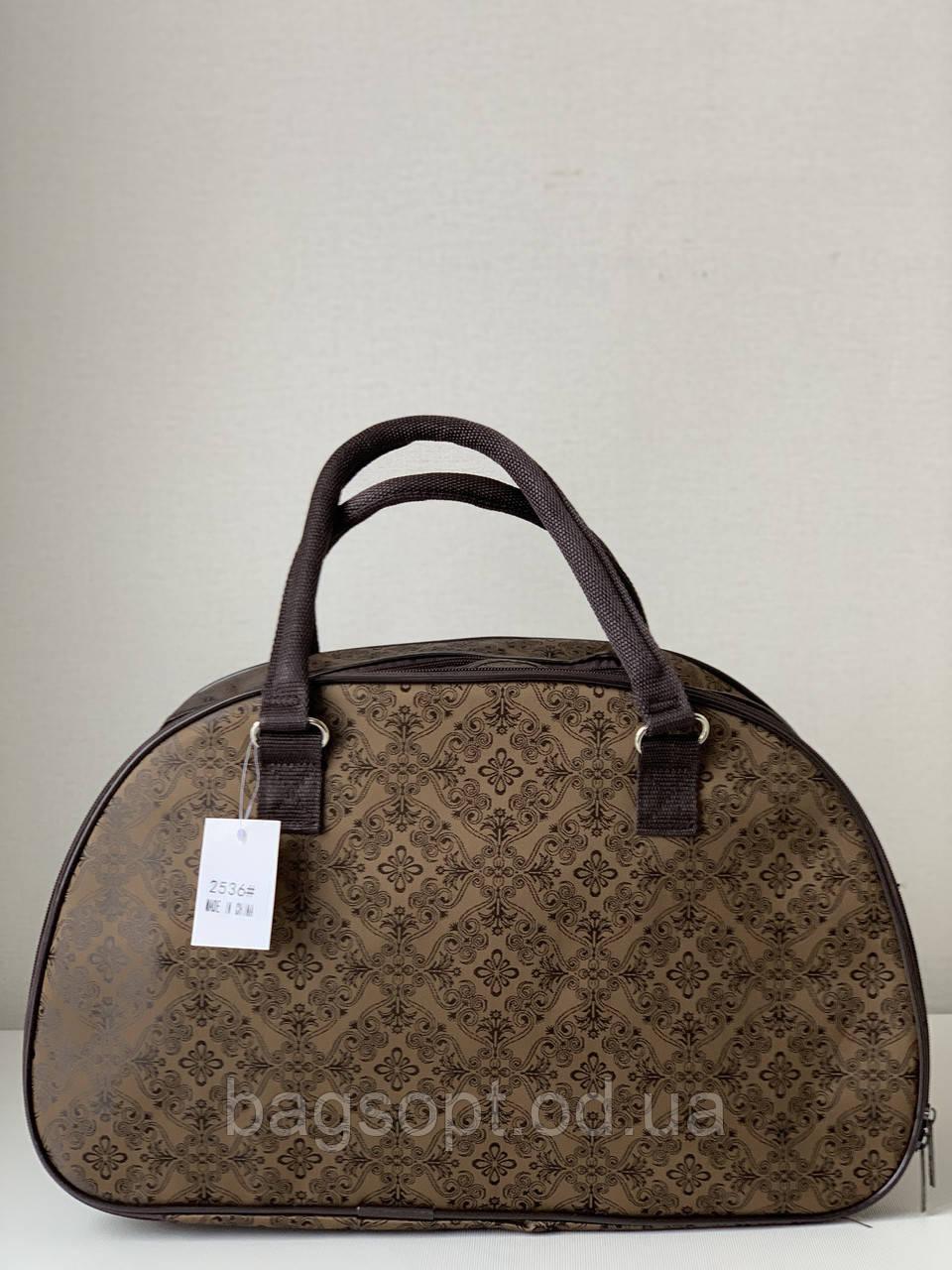 Коричневая женская дорожная сумка-саквояж с ручками и плечевым ремнем ручная кладь