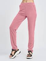 Розовые трикотажные штаны с карманами