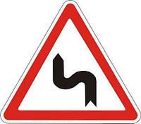 Дорожный знак 1.3.2 - Несколько поворотов. Предупреждающие знаки. ДСТУ
