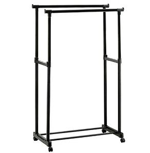 Двойная стойка для одежды черного цвета на колесиках.