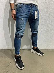 Мужские джинсы зауженные порваные
