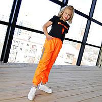 Оранжевые спортивные брюки влагозащитные на девочку рост 134-176
