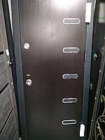 Двери входные с планками и нержавеющими вставками 860 * 2050