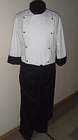 Спецодежда повара, белый китель с фартуком и брюками черного цвета