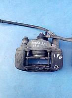 Суппорт тормозной передний левый BR75-33-71X Mazda 323, MX-3