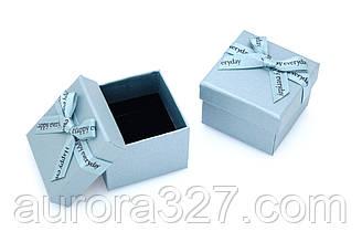 Картонна коробка для кілець блакитна.