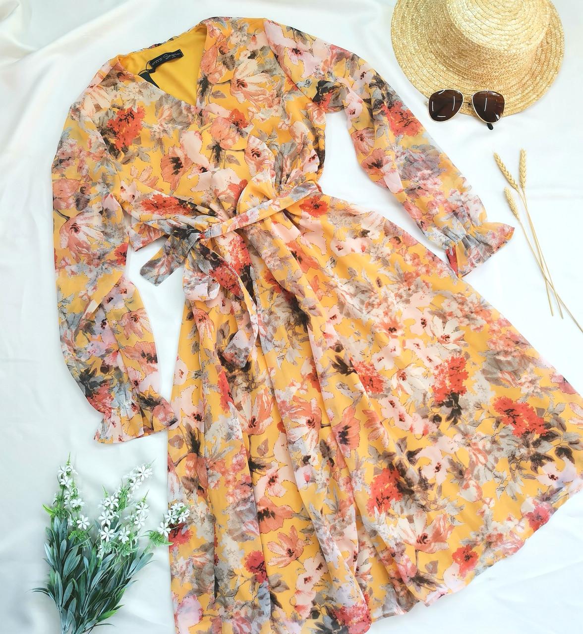 Жіноче помаранчеве плаття з квітковим принтом
