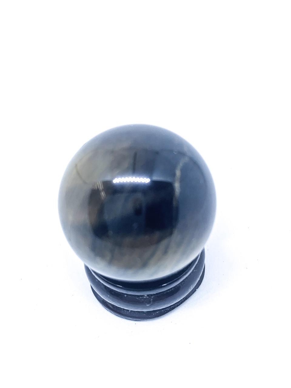 Куля тигрове око на підставці
