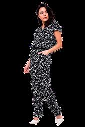 Жіночий комбінезон з квітковим принтом чорний 411-2