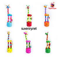 Дитячі іграшки танцюючі дерев'яні жирафи, фото 1