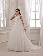 Нежное свадебное платье с кружевным лифом и шлейфом