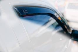 Дефлекторы окон (ветровики)  Renault Logan 2004-> 5D combi 4шт (Heko)
