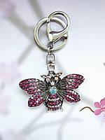 Брелок бабочка никель в стразах розовый (130572)