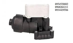 Радиатор масляный / теплообменник (с корпусом) VW Caddy III 2.0TDI 103kW 07-10  NRF (Нидерланды) 31355