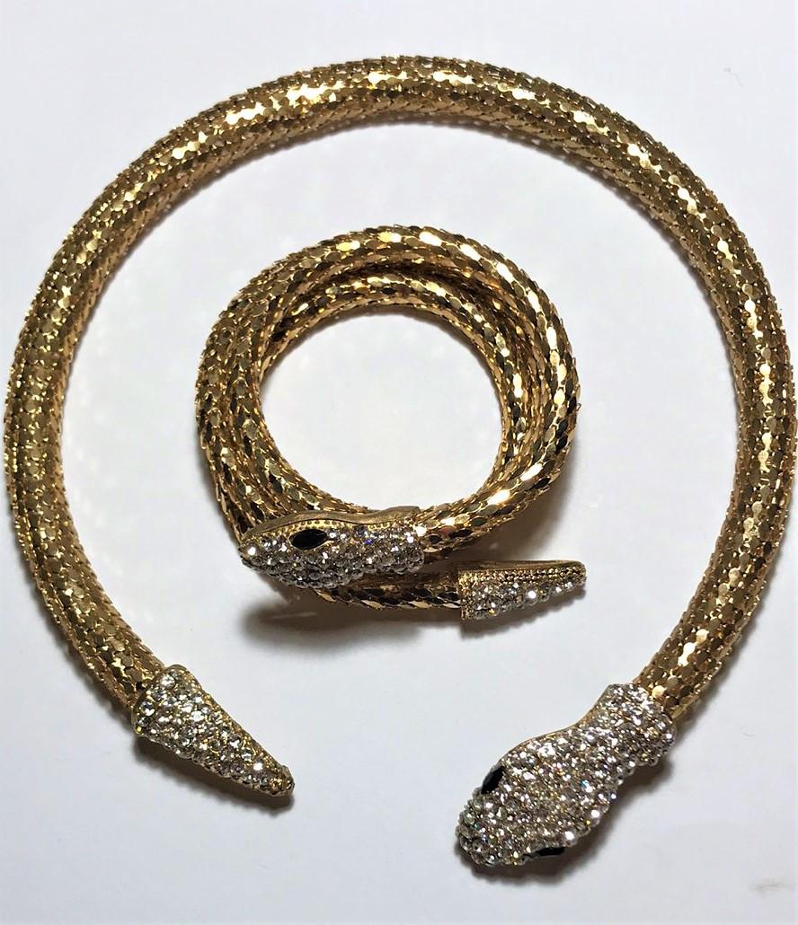 Набор колье и   браслет  золотого  цвета с кристаллами в виде   змеи