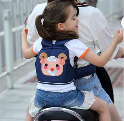 Ремені для безпечного перевезення дітей на велосипеді, мопеді.