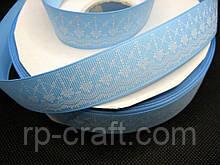 Стрічка репсова, новорічна. Орнамент на блакитному тлі, 25 мм