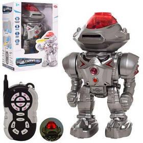 Робот 9896 р/у,30 см, муз, зв(англ), свет, ходит, стреляет дисками, бат, в кор-ке 21,5-32-15,5 см
