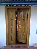 Двері вхідні дерев'яні з масиву дерева (сосна, шпонована дубом), доставка по Україні
