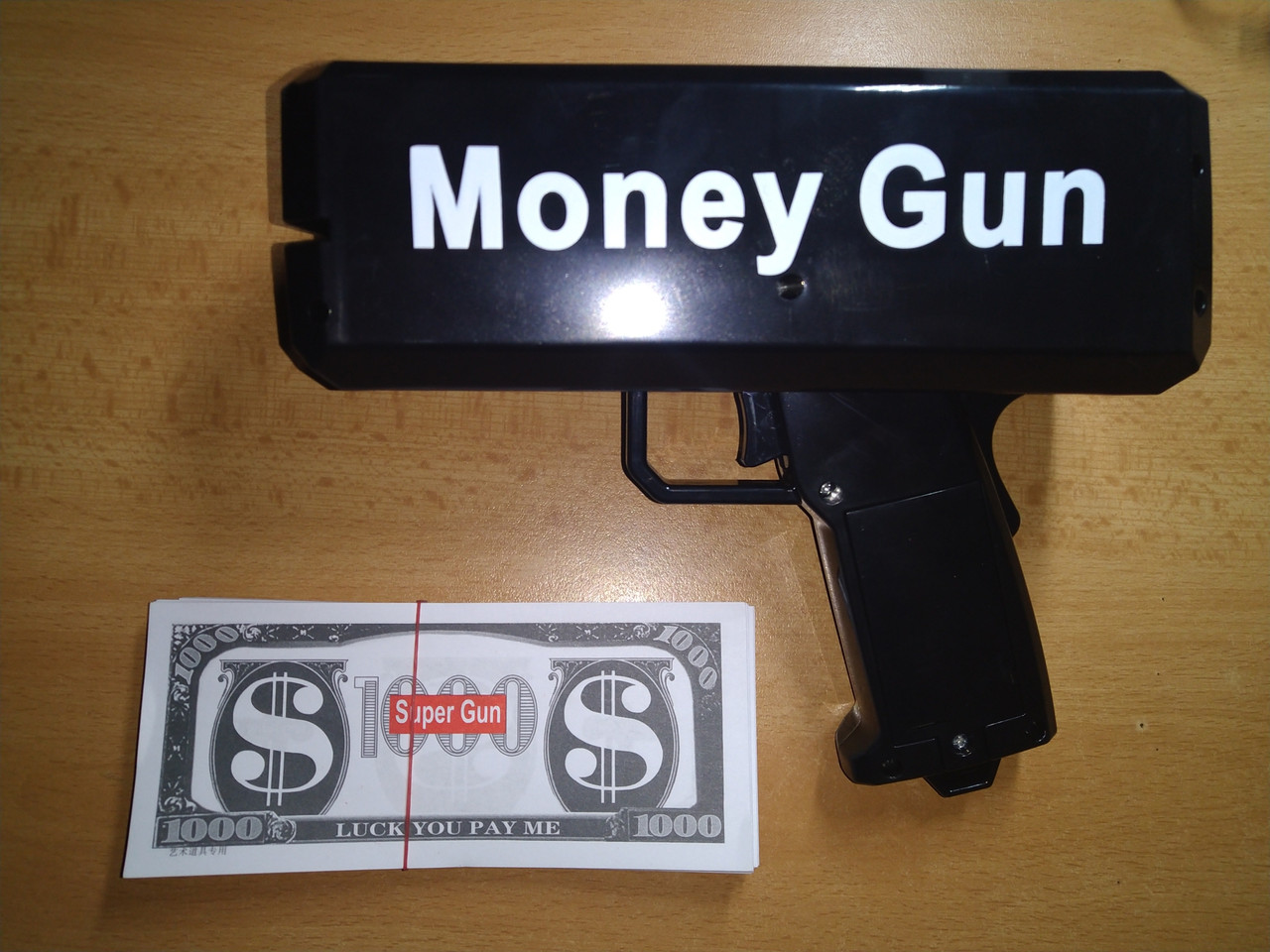 Пистолет для денег деньгомет