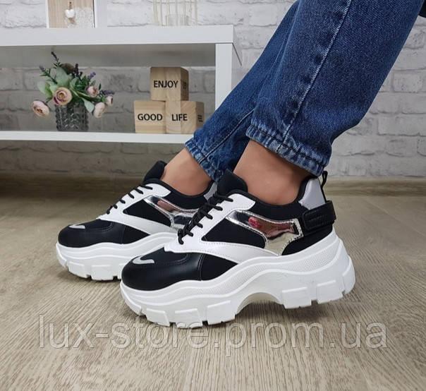 Кроссовки чёрные с белым на массивной тракторной подошве