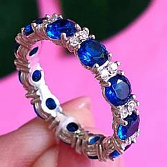 Брендовое серебряное кольцо с цирконием по кругу - Серебряное родированное кольцо с синими камнями