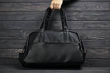 Шкіряна сумка.