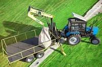 Тракторный полуприцеп DL Agromaster с гидроманипулятором